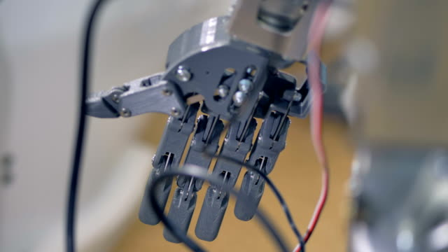 Detailed view on a gray unmoving robots hand. video