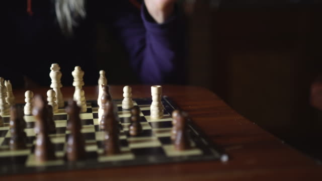 Details playing chess inside mountain cabin
