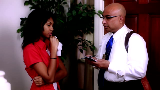 detective talking to victim A lovely upset African American girl gives a statement to a detective in her home. police interview stock videos & royalty-free footage