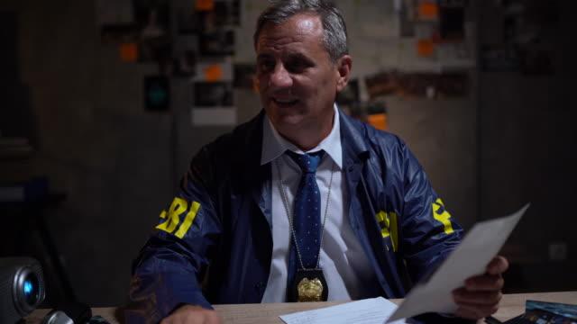 FBI detective using magnifying glass at work