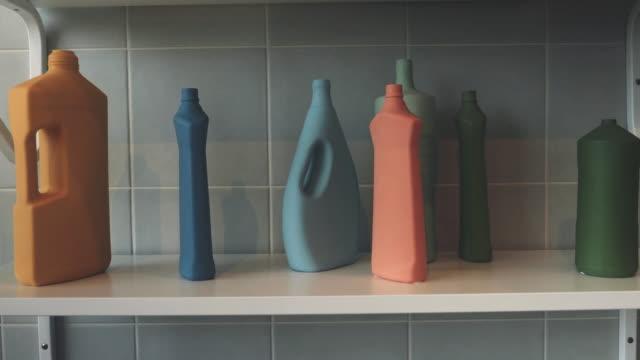 detergent bottles on metal shelf - disinfectant stock videos & royalty-free footage