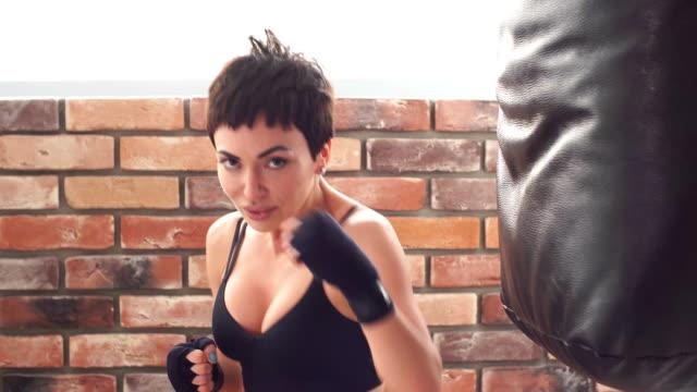 determensd athlete focused on boxing technique - kick boxing video stock e b–roll