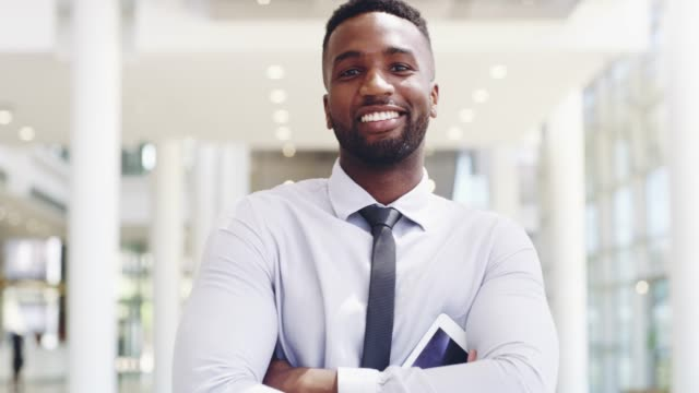 Determination to succeed is everything 4k video footage of a confident young businessman working in a modern office bolos stock videos & royalty-free footage