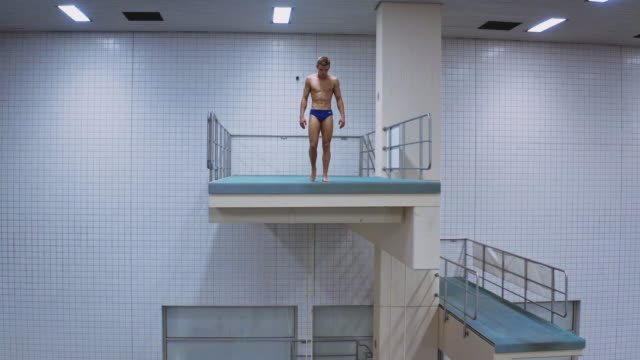 Determined male athlete preparing for high dive