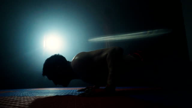 determined man doing push ups - weightlifting stock videos and b-roll footage