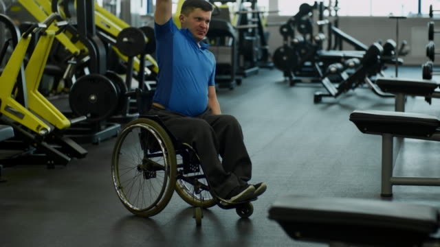Determined Man in Wheelchair Training in Gym video
