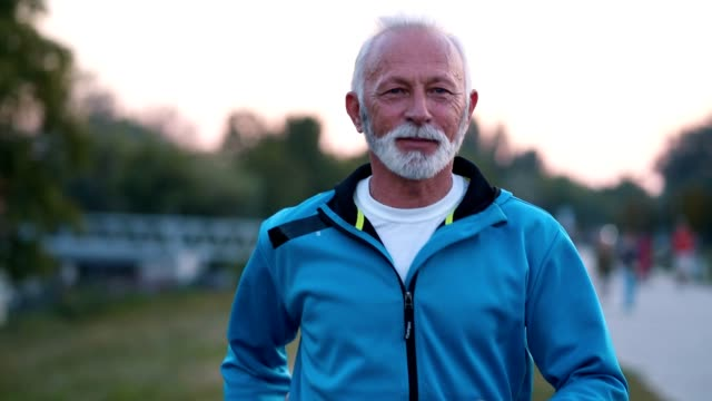 Determined senior man jogging Active senior man jogging on the running track outdoors. hobbies stock videos & royalty-free footage