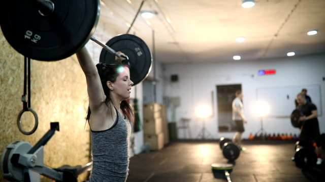 Determined young woman doing deadlifting in the gym Determined young woman doing deadlifting in the gym,slow motion cross training stock videos & royalty-free footage