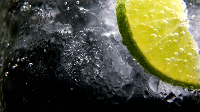 Detox or thirst concept. Healthy, dietary nutrition. Cold lemonade, lime drink. Black background