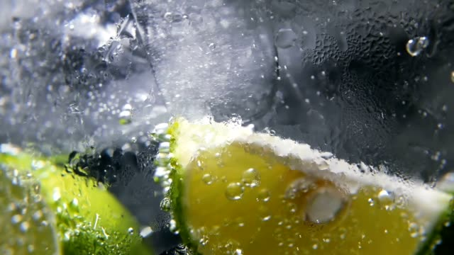detox or thirst concept. healthy, dietary nutrition. cold lemonade, lime drink. black background - vodka video stock e b–roll