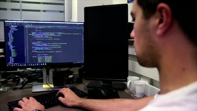 Developing programming and coding technologies. Website design. Programmer working in a software develop company office. Developing programming and coding technologies. Website design. Programmer working in a software develop company office. it professional stock videos & royalty-free footage