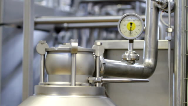 Device for measuring pressure in pipes Device for measuring pressure in pipes. Equipment at dairy plant. stainless steel stock videos & royalty-free footage