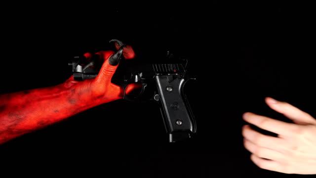 Devil gives a gun to a man. 50 fps video