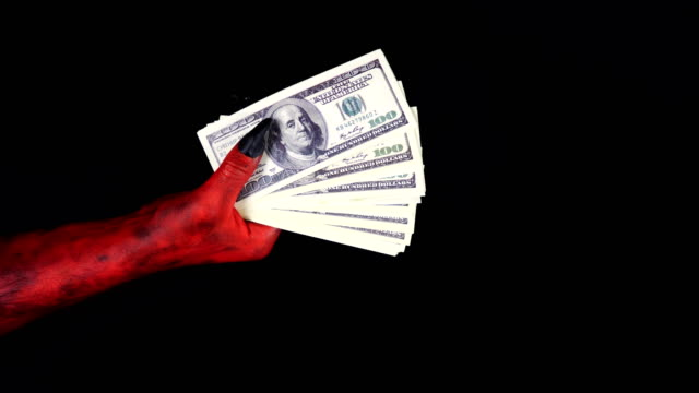Devil gives a pile of money to a businessman. 50 fps video