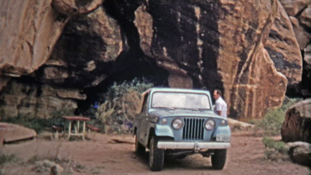 1971: Devils Kitchen campsite proves to be a scenic place for lunch for a Jeep driver.