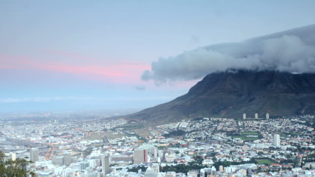 Devils Peak Dusk Time lapse of the transition of day to night, overlooking the Devils Peak side of Table Mountain and Cape Town city. table mountain national park stock videos & royalty-free footage