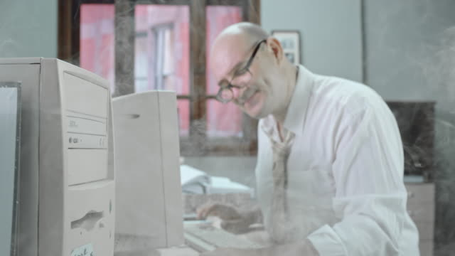 DS Devoted accountant working on computer caught in smoke video