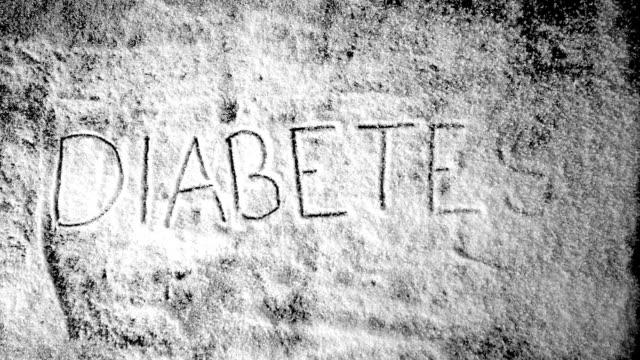Diabetes written into sugar powder being blown away video