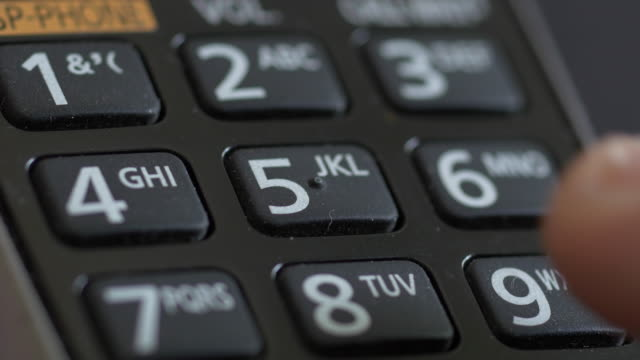 Dialing 911 emergency call Extreme close up of a touch tone cordless phone keypad dialing 911 emergency call. cordless phone stock videos & royalty-free footage