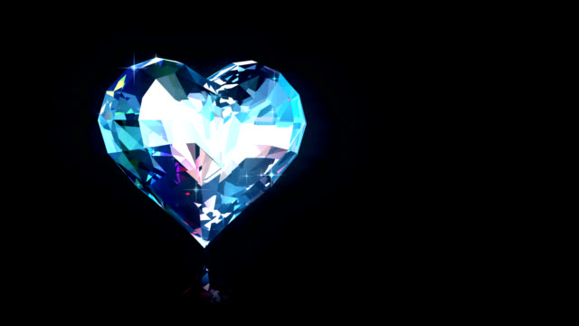 Diamond heart rotates Render of  diamond heart rotates being reflected in a black background (alpha matte) diamond stock videos & royalty-free footage