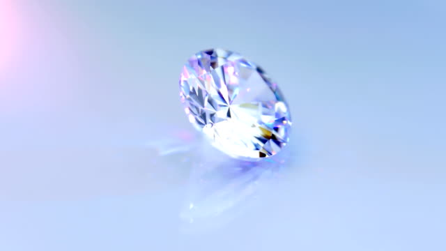 Diamond shimmers in the rays of light. Closeup video