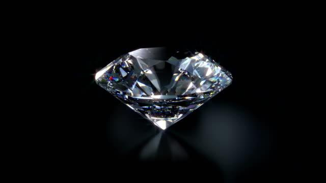 loop di rotazione diamond primo-up 4k con chiave alfa - brillante video stock e b–roll