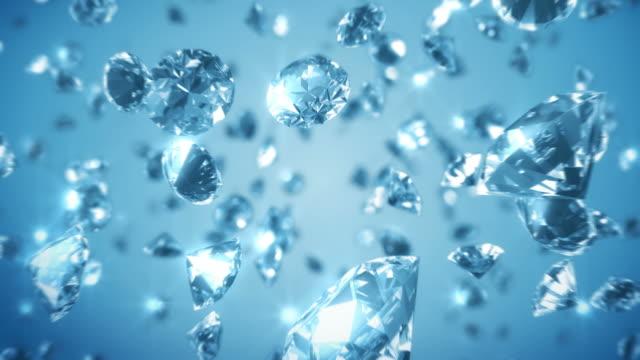 diamond zoom blue background - loopad bild bildbanksvideor och videomaterial från bakom kulisserna