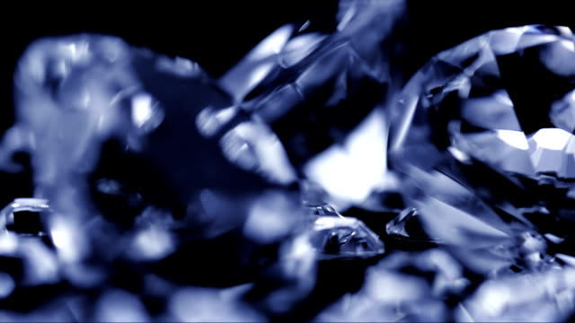 Diamonds On Black Background HD1080p: Close-up shot of a group of diamonds rotating on a black background. diamond stock videos & royalty-free footage