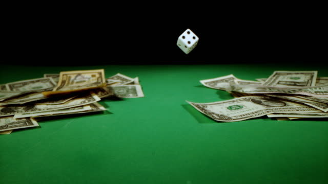 SLO MO Dice falling on a gambling table