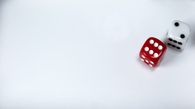 Dice rolling against White background, slow motion 4K video