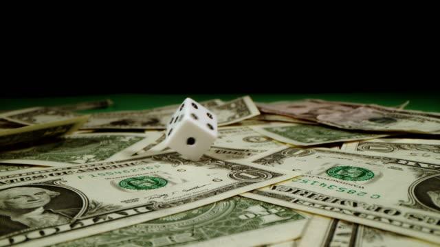 SLO MO Dice spinning on dollars