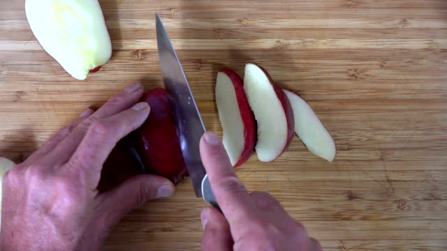 Dicing an apple, overhead view video