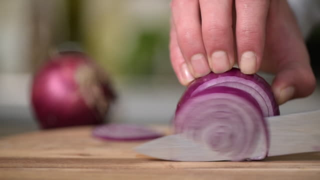 Dicing Red Onions on a wooden chopping board video