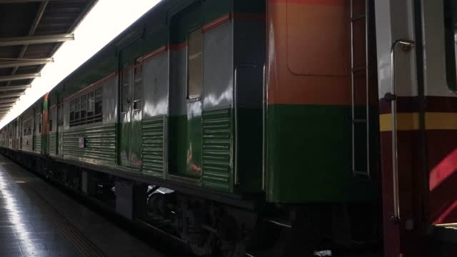 diesel train is crossing in Railway station. railway station in Bangkok to travel across the country. Rail transport to transport people.
