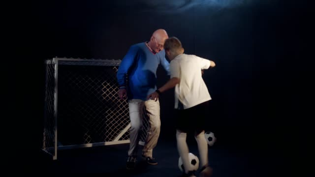 Different Age Family Soccer. Grandfather And Grandson Are Playing Football Enthusiastically video