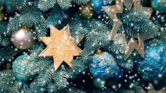 Different decorative Christmas-tree toys close-up video