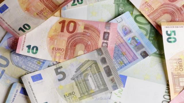 different euro-banknotes turning - valuta dell'unione europea video stock e b–roll