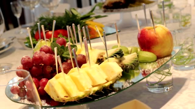 Different fresh fruits on wedding buffet table. Fruits and berries Wedding table decoration. Wedding, New Year, Christmas table decoration. video