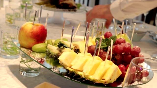 different fresh fruits on wedding buffet table. fruits and berries wedding table decoration. wedding, new year, christmas table decoration. - фуршет стоковые видео и кадры b-roll