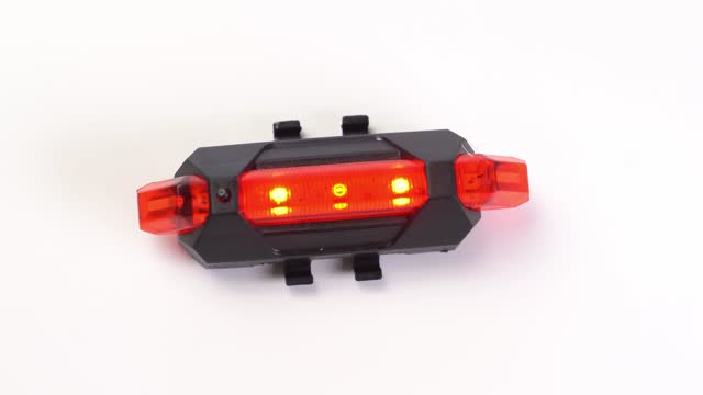 Different modes of operation of the rear red lantern for the bike.