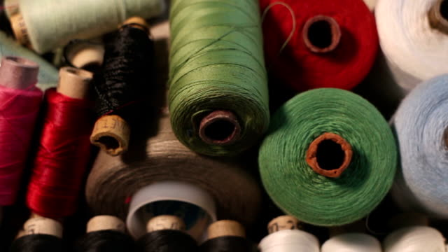 different sizes coil of thread - cilindro video stock e b–roll