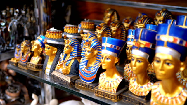 Different Statuettes of Egyptian Souvenirs on Market Stall