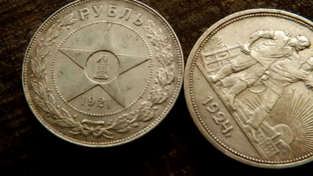 Different Symbols of USSR Sickle, Hammer, Farmworkers, Workers, Star on Old Soviet Silver Coins Macro video