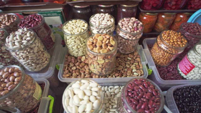 Different varieties of different seeds, beans and nuts on local food market of healthy food