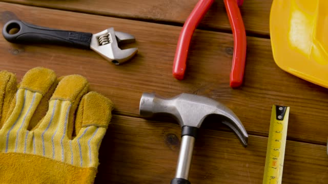 different work tools on wooden boards - klucz ręczne narzędzie filmów i materiałów b-roll