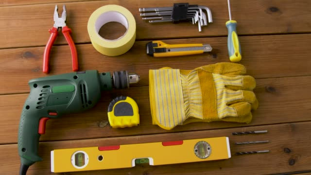 different work tools on wooden boards repair, building and carpentry concept - different work tools on wooden boards wrench stock videos & royalty-free footage