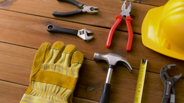 different work tools on wooden boards
