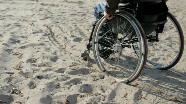 Difficulties movement people with disabilities Disabled man in wheelchair, makes failed attempts steer wheelchair, over obstacle video