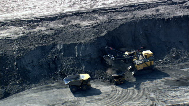 Digger And Two Trucks  - Aerial View - Wyoming, Campbell County, United States video