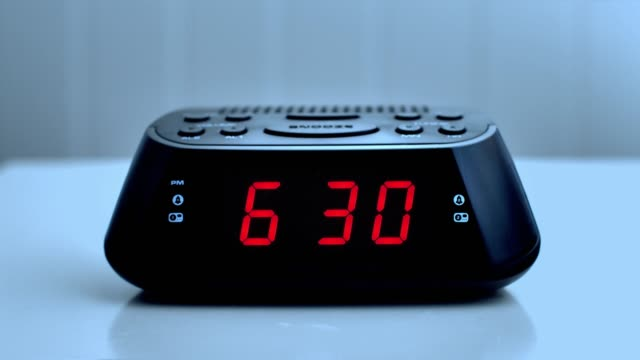 Digital alarm clock, time from 6.29 to 6.30.